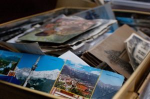 A box filled with postcards