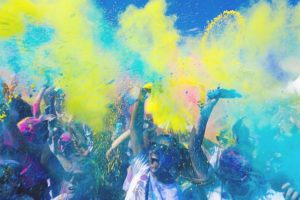 A group of people in colored powder.