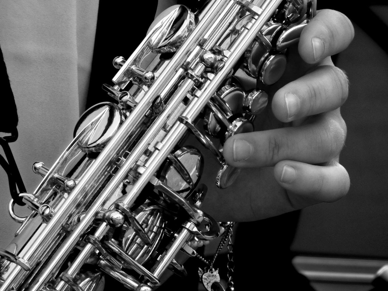 Black and white photo of a man playing the saxophone.