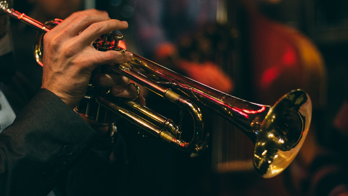 A person playing the trumpet.