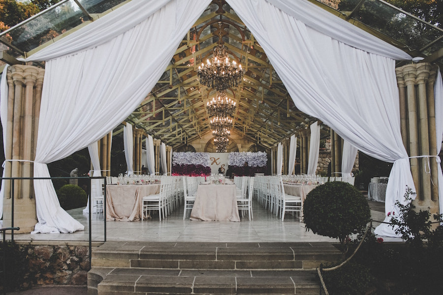 Canopy with table and chairs at a New Orleans wedding venues.