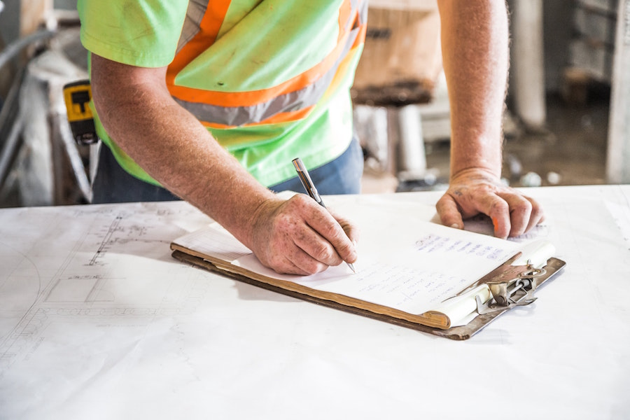Home inspector writing a report